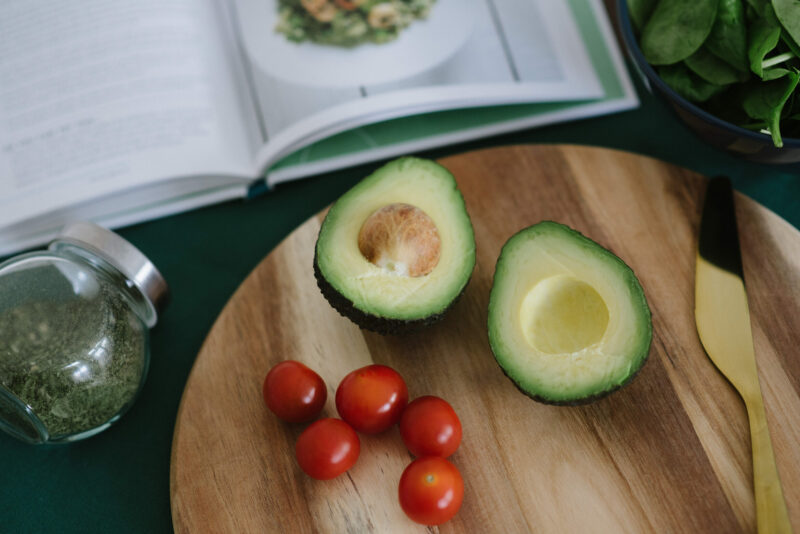 sliced avocado on a cuttng board