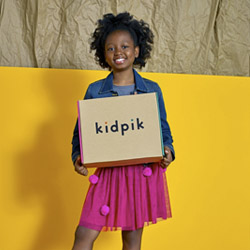 kid pik model holding a subscription box